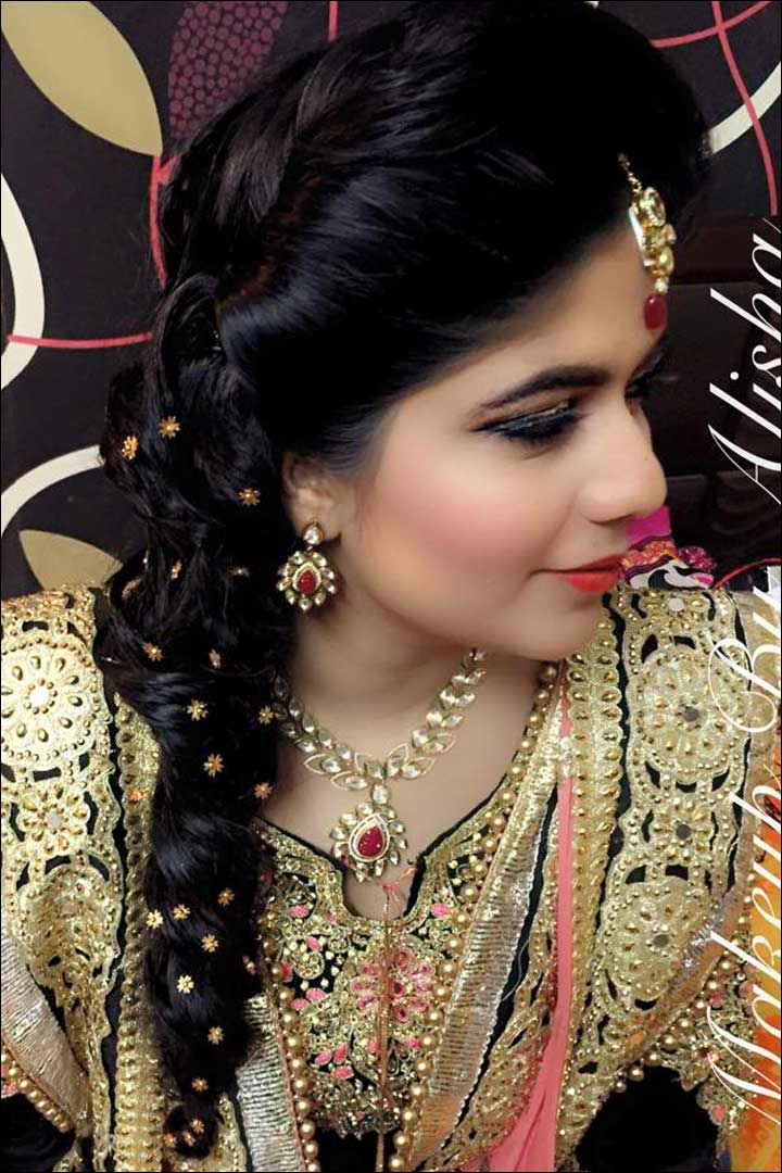 South Indian Bridal Hairstyles For Receptions - Curly messy one-sided braid