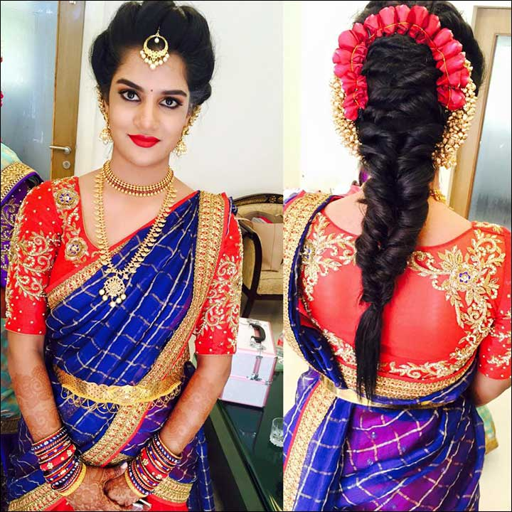 South Indian Bridal Hairstyles For Receptions - Fishtail with flowers