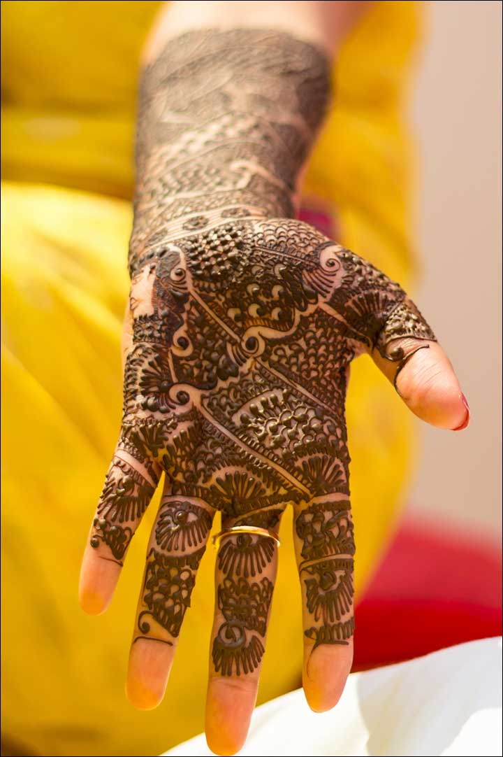 Mehndi style has finger tips left free to accentuate the design