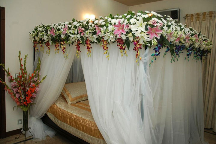 Wedding room decorations 10 ideas to make the festivities memorable wedding night decoration canopy with exotic orchids junglespirit Images