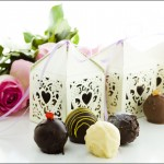 Square-white-decorative-lace-heart-favor-boxes-filled-with-gourmet-truffles
