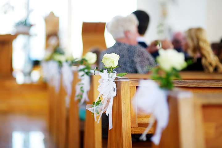 Wedding-Pew-Decorations-with-A-Single-Rose