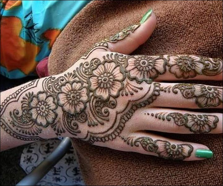 Detailed Rose Mehndi Art For The Back Hand