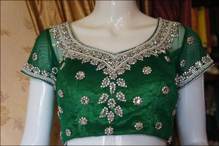 Maggam Work Blouse Designs - Green Studded Maggam Work Blouse With Heavy Neck Embroidery, Transparent Sleeves & Mirror Work