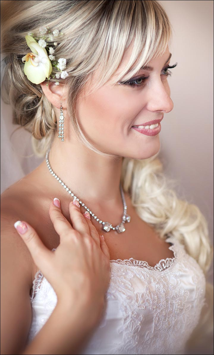 Soft-Curls,-Bangs-And-Floral-Accessory-romantic-wedding-hairstyles